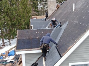 Ice & Water Shield being applied on a Deep River wood roof installation.